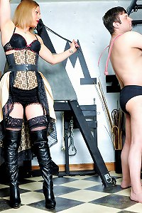 Hot femdom minx gets her whips out and thrashes her slave with full force