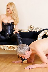 Leather clad femme decided she wants her boots worshipped and kissed by two pathetic boot slaves