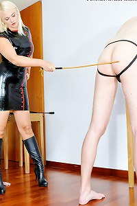 Tall domme in latex canes Male sub