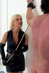 Cruel bitch corporal punished naked slaveboy with the cane
